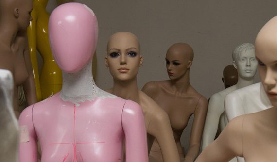 The mannequins are hand-made in the old factory. The workers daub the liquid fiberglass inside the molds and wait until it is dry. A worker can make more than ten mannequins a day.