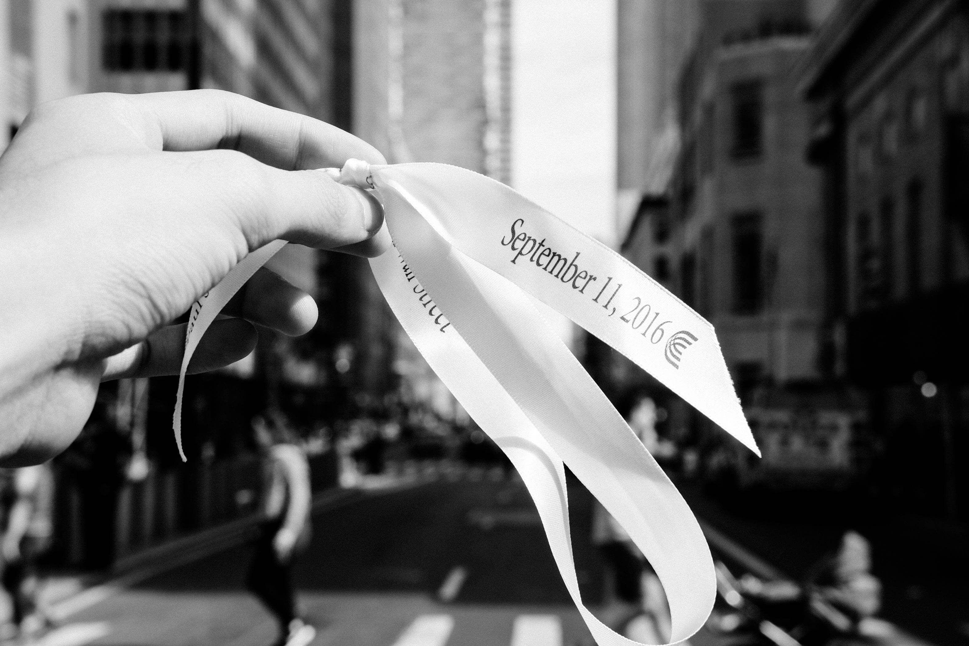 A tourist takes photo of a ribbon which written with words of blessing outside St. Paul's Chapel