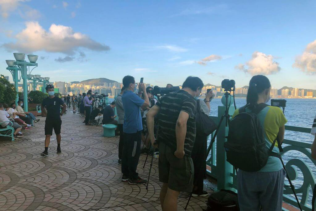 """Hundreds gather at Whampoa promenade, an optimal viewing location suggested by Hong Kong Space Museum, for the """"super blood moon""""."""